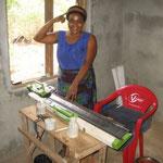 A woman making hair nets