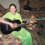 Hannah playing Dads new guitar