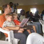Eric reading to the boys during a long church program