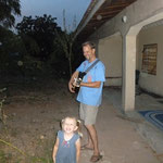 playing guitar near our front porch