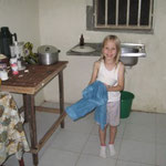 Emily drying dishes in our Kitchen at the guest house in Port Harcourt