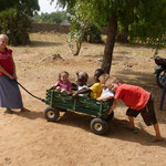 The kids enjoying one of their Christmas presents. We bought the wagon months prior while we were still in Jos. It was hard to hide.