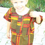Caleb dressed in his Nigerian cloth