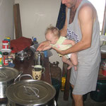 Naomi is helping dad plunge the coffee in his french press.