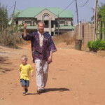 Eric & Elijah walking the streets of Kaduna