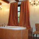 Hayloft rooms bathroom with jacuzzi bath, shower, sink, bidet and toilet