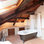 Mansarda rooms bathroom with claw footed bath with shower, sink, bidet and toilet
