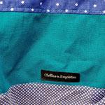 gros plan sur les tissus couleur anthracite, bleu marine et turquoise