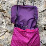 besace en tissus rose et violet ouverte