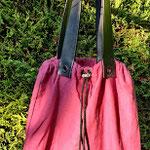 sac baluchon couleur framboise