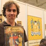 Dujardin mit dem Spiel Troyes (Boardgamegeek.com)