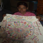 This deaf and mute woman embroidered this tablecloth. She is proud to bring joy to others through her work and be able to help her family with her income.