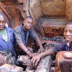 Getting to know lorries is part of the training – former street children repairing a lorry's diesel engine.