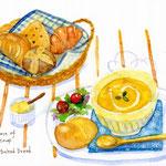 焼きたてパンと温かいスープ