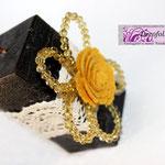Candela uncinetto e fiori in pietre sfaccettate