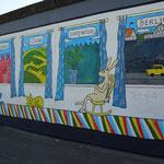één van de tekeningen op de Berlijnse muur