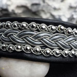 N r25./425:- svart skinn med grått läder