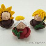 Tortenfigur Wichtel Sonnenblume, Margarite und Löwenzahn