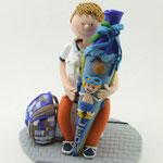 Tortenfigur Schulanfänger Junge sitzend auf Startblock