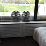Door stefig op maat gemaakte radiator ombouw met horizontale latten.Gemonteerd in Ridderkerk.