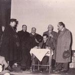 """Febbraio 1954. Distribuzione """"pacchi ECA"""" (Pacchi alimentari USA per le famiglie povere)Nella foto-Il brigadiere Pirro, don Pasquale Gallina, Raffaele Mazziotti, De Gennaro"""