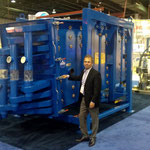 A.J. DeCenso stands with a SWECO BigMax sifter, the largest such machine ever displayed at the Powder Show.