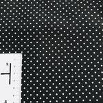 Schwarz mit weißen Punkten