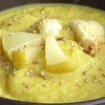 Crema de coliflor i poma al curry