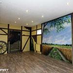 Wandbilder mit Farbe an die Wand gemalt