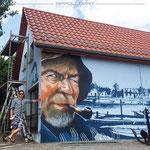 Fischerei Geschäft mit Hilfe der Graffitikunst neu entstanden Fassaden Konzept