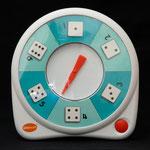 All-Turn-It Spinner: Diese elektronische Zeigeuhr wird entweder über den eingebauten Taster oder mit einem angeschlossenen Taster ausgelöst. Der Zeiger bleibt nach dem Zufallsprinzip auf einem der Felder stehen.