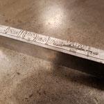 ein vierzeiliger Linotypoe-Maschinensatz