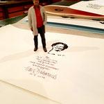 Hans als 3D-Druck neben seinem Eintrag in mein Wanderbuch