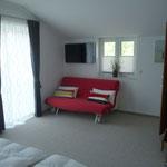 Ausziehcouch im Schlafzimmer 1
