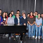 Die slowakische Gruppe singt im Chor.
