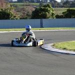 Keith Robertson (29) powers his machine around the tight bend