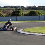 Mitchell Day (95) chucks his kart into the turn