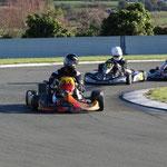 David Cox (23) corners hard around the pits bend