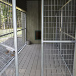Kennel runs are custom made by a company in California that builds zoo cages. They have 6 gauge wire, welded to double crossbars on each panel