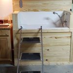 A walk-in dog bath makes bathing much easier on the back. Kennel building also has a dual bowl kitchen sink & feeding station, grooming table with steps, and its own 40 gallon water heater. It is also heated and insulated