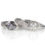 Drei Ringe in Platin und Weißgold mit grauem Tansanit oder Brillanten