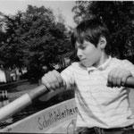 Johannes, Sohn von Matthias Biskupek in einem Ruderboot des Heims auf dem Schwielowsee. Mai 1987.