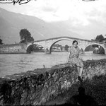 1929. Lina grandmother near the Ganda bridge in Morbegno (SO).