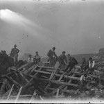 1922-1927. A group of walkers of SAT (Società Alpinisti Trentini) from Rovereto (TN) near a few ruins of a refuge destroyed during the First World War.