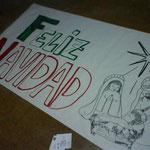 Detalle del cartel realizado por la Capilla para felicitar la Navidad.