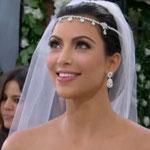 Peinado de novia con velo y bandida de cristales y diamantes