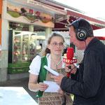 Moderator Wolfgang Hüttner mit mir beim Interview.