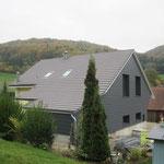 Dach-Fassadensanierung mit Zimmerausbau