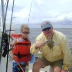 Charlie of Atlanta age 5 catches a puffer fish