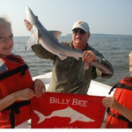 Elizabeth (7) and Patrick (5) Tilt of Smyrna, GA with one of the largest Atlantic Sharpenose sharks of the year!
